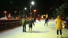 People slide along skating path near Fountain of Friendship of Peoples Stock Footage
