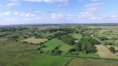 Farm land houses sunny day Stock Footage