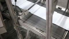 Conveyor band with sheets of newspaper in print house. Stock Footage