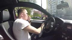 Man Vapes Driving Car Stock Footage