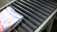 Packed in packaging film stack of magazines move by rolls at storage Stock Footage