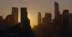 The sun peeks out from behind the Manhattan Skyline. Stock Footage