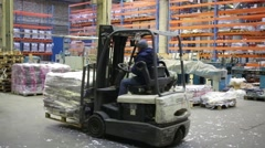 Man on loader works in warehouse of Printing House Pushkin Square. Stock Footage