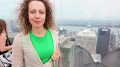 Woman with quadrocopter stands at Observation Deck Top Stock Footage