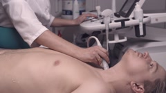 Doctor examinating man with ultrasonography Stock Footage