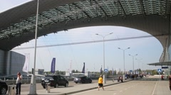 People and cars near terminal at Sheremetyevo Airport. Stock Footage