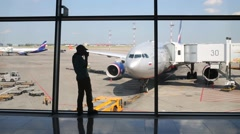 Woman and boy who shoots airplanes at Sheremetyevo Airport Stock Footage