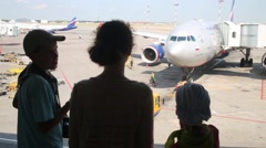 Woman and children look at workers of Sheremetyevo Airport. Stock Footage