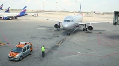 Employee of parking service manages aircraft parking in Airport Stock Footage