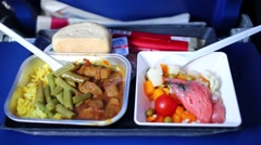 Food at tray during flying on airplane. Zoom in and then back out Stock Footage