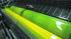Yellow Paint Running Off a Roller in Printing Press Stock Footage