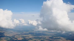 Cumulus clouds and smaller drifting over them with greater speed. Stock Footage