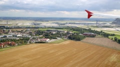 Landscape and airplane wing during aircraft comes in for landing. Arkistovideo