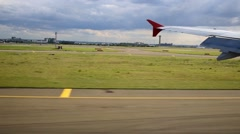Airdrome field and airplane wing during touchdown. - stock footage