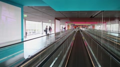 Moving walkway and passage for passengers inside building of airport. Stock Footage