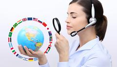 Concept search, customer service operator woman with headset, globe, flags an Kuvituskuvat