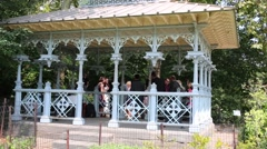 Pavilion with wedding and children playing on rocky stones Stock Footage