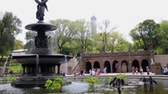People walk around Bethesda Terrace with Bethesda Fountain Stock Footage