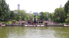 People walk at Bethesda Terrace with Bethesda Fountain Stock Footage