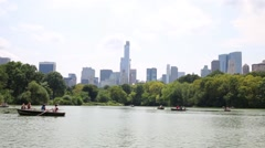 People resting in oar boats on pond in Central Park of New York Stock Footage