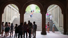 People walk in Arcade near Bethesda Terrace in Central Park Stock Footage