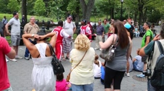 Two black guys entertain visitors of Central Park in New York. Stock Footage
