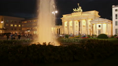 Brandenburg Gate Berlin in Germany, Europe illuminated at Night with fountain Stock Footage