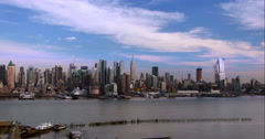 A beautiful blue sky day on the Manhattan Skyline. Stock Footage