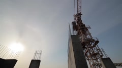 Construction of a concrete building in the background tower crane Stock Footage