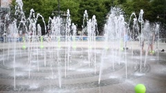 Children in the public fountain area have a refreshing bath. Stock Footage