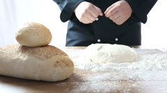 sprinkle with flour and knead the dough - stock footage