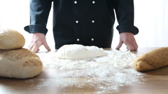 Stock Video Footage of knead the dough on a wooden table