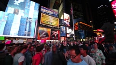 Crowd of people at pedestrian area on Broadway in the night. Stock Footage