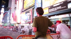 Man controls quadrocopter at pedestrian area on Broadway Stock Footage
