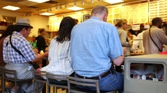People have breakfast at Zabars cafe on Broadway at 80th Street. Stock Footage