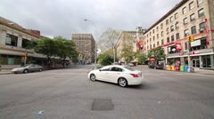 Daytime cars traffic at crossroad Broadway and 80th street Stock Footage