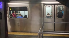 Subway train leaves subway station in New York City Arkistovideo