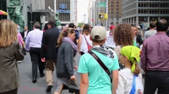 Crowd of people at intersection of 6th Avenue and w52th street Stock Footage