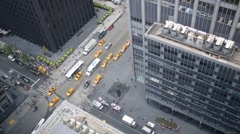 Daytime vehicle traffic at road, view from window above. Stock Footage