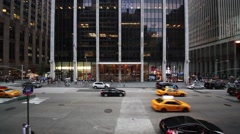 Cars traffic at 6th Avenue against office building of glass. Stock Footage