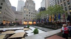 People walk by Rockefeller Plaza. Rockefeller Center Stock Footage