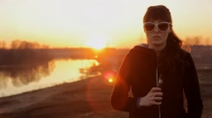 Girl in sunglasses at sunset smoking electronic cigarette Stock Footage