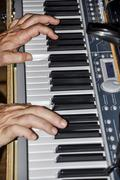 Musician playing on keyboards Stock Photos