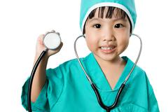 Asian Little Chinese Girl Playing a Doctor with Stethoscope Stock Photos