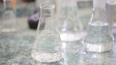 Tubes and beakers on table Stock Footage