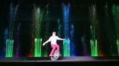 Equilibrist biker performs during  christmas performance at circus Stock Footage