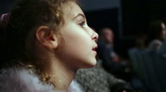 Closeup profile face of little girl dressed in fur mantle Stock Footage
