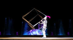 Juggler-skater juggles with cubic frame during  christmas performance Stock Footage