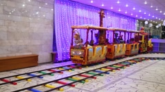 Children ride on the train in hall of circus of dancing fountains Stock Footage