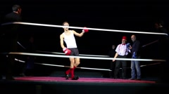 Clown boxer wanders around after gets hit in ring on stage Stock Footage